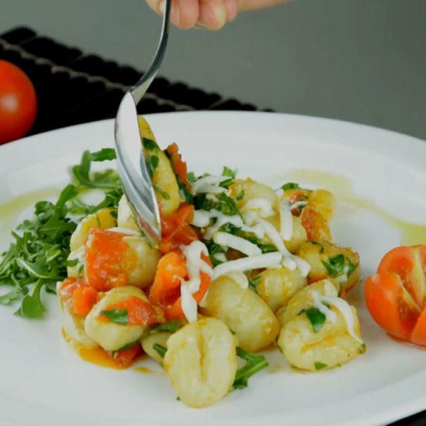 Patato Gnocchi with cherry tomatoes and arugula